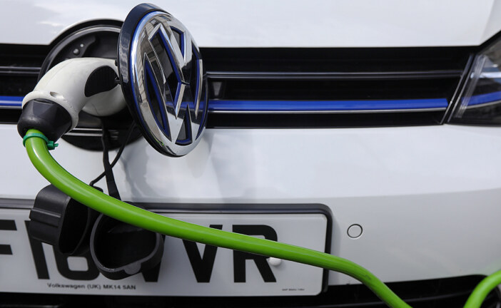 Electric car threatens oil's century-long reign, but change will be slower than the hype