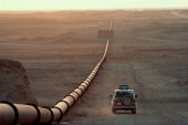U.S. crude slips on inventory build, gasoline rallies