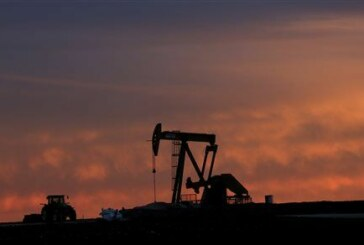 Oil edges higher with Wall Street