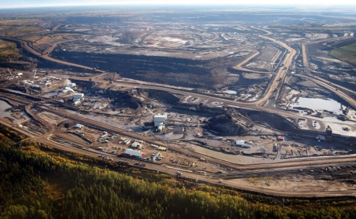 Suncor, Teck buy part of Total stake in Canada oil sands mine