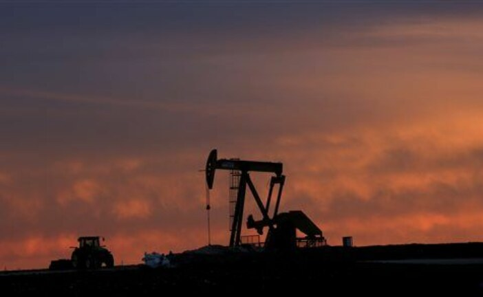 Oil settles higher in volatile pre-holiday session