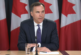 Morneau vows oilpatch support through Trans Mountain as protesters chant outside