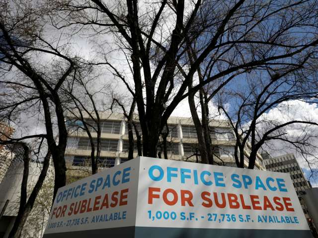 A sign advertising office space for sublease in Calgary.