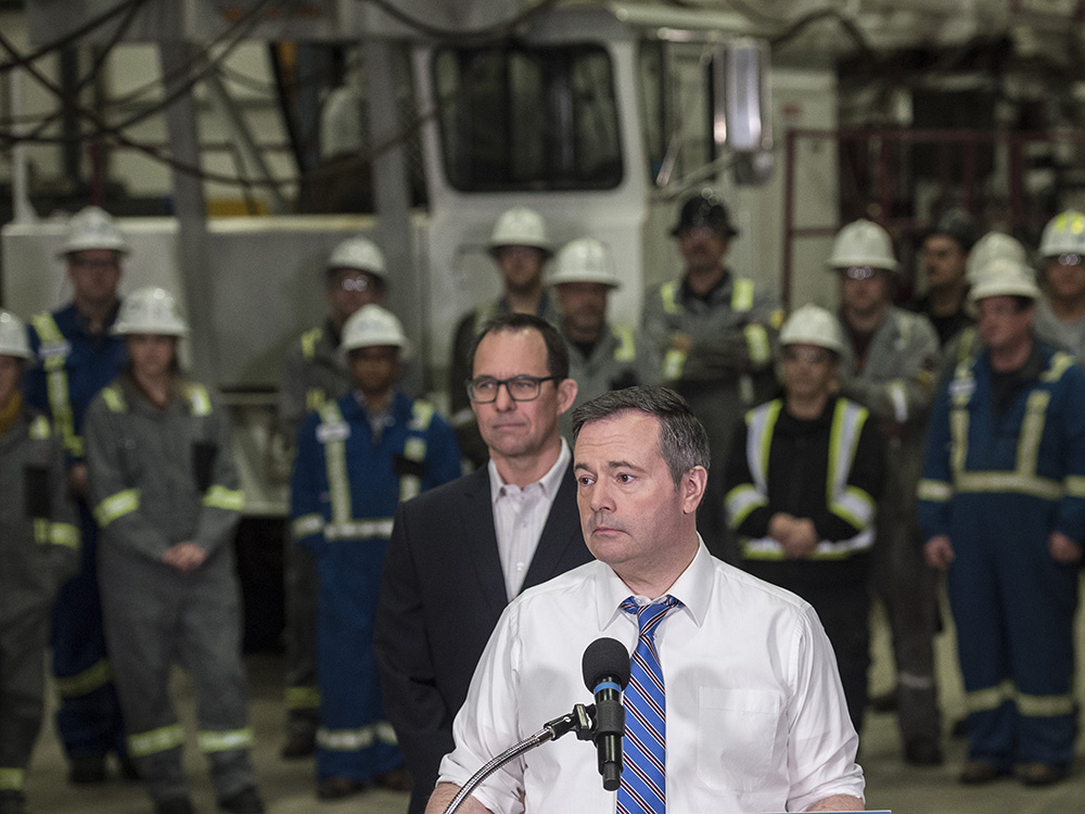 Premier Jason Kenney announces a $100-million government loan to the Orphan Wells Association. He appears with Lars De Pauw, executive director of the organization.