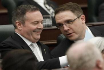 Alberta politicians return to legislature to pass bills, keep their distance