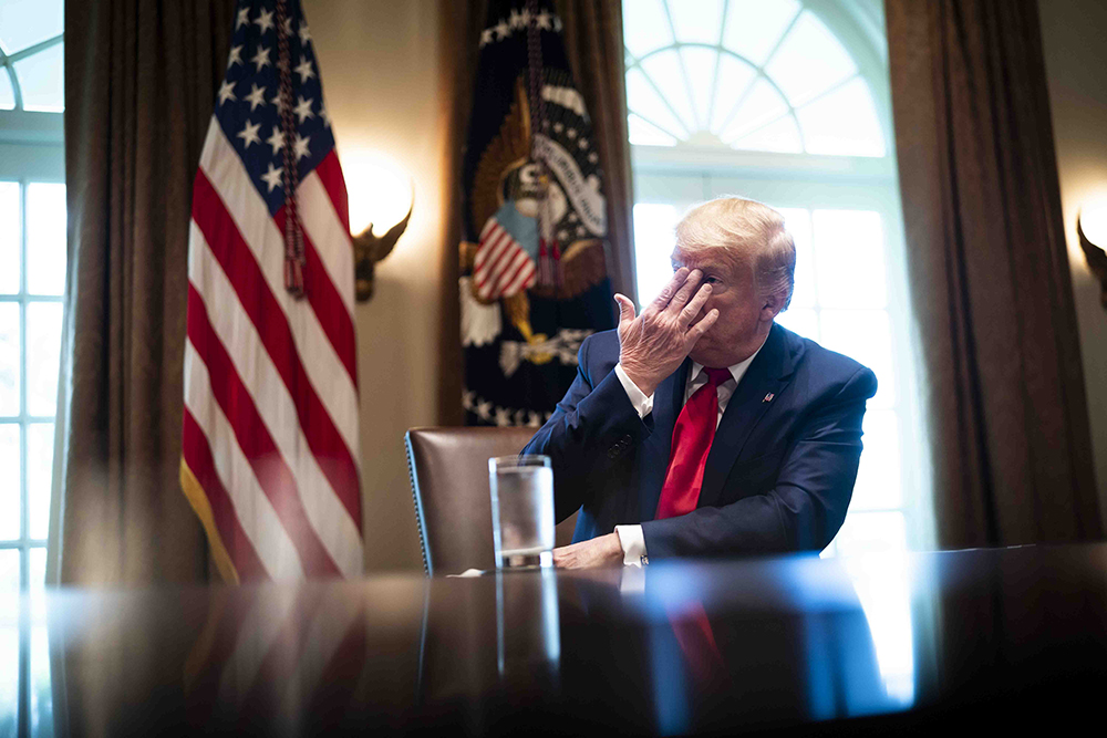 U.S. President Donald Trump listens during a roundtable meeting with energy sector CEOs in the White House on April 3.