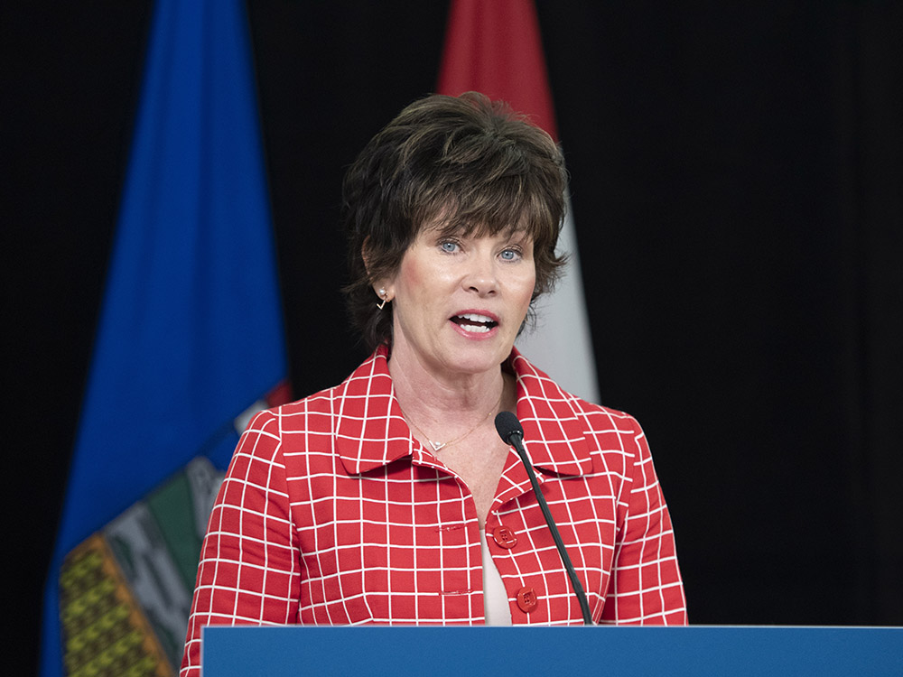 Energy Minister Sonya Savage explains the well site rehabilitation program during a press conference in Edmonton on Friday.