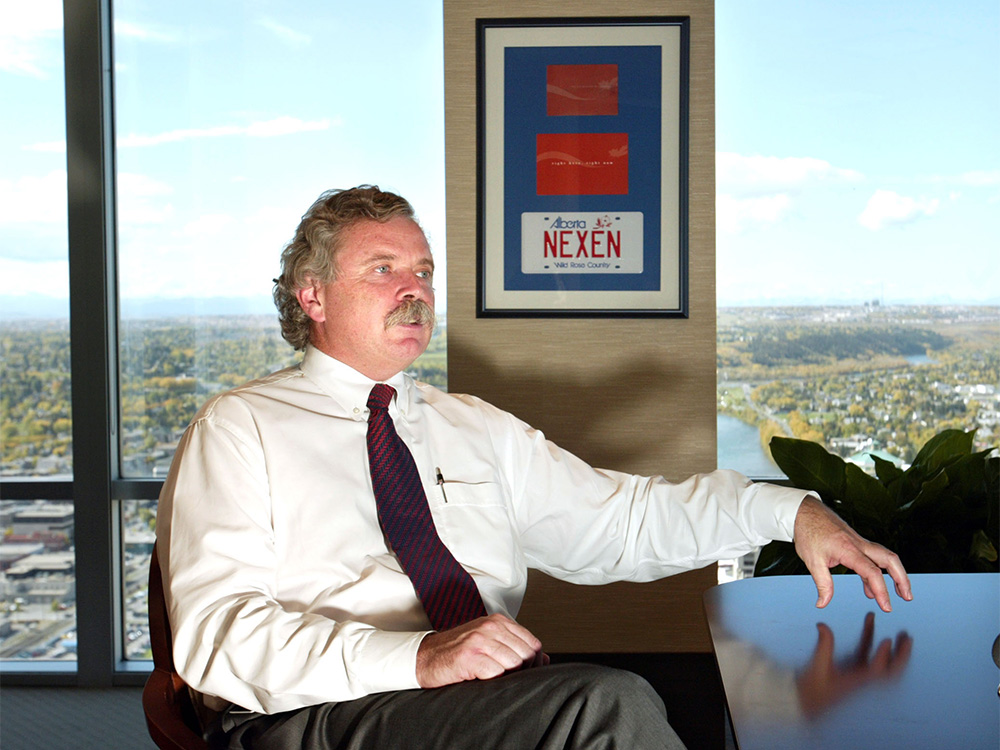 Charlie Fischer at the helm of Nexen at its Calgary headquarters on Sept. 22, 2004.