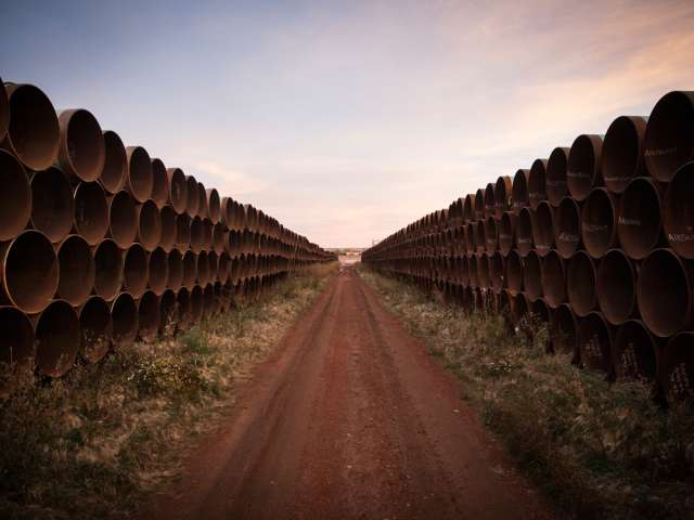 Miles of unused pipe for the Keystone XL expansion in North Dakota.