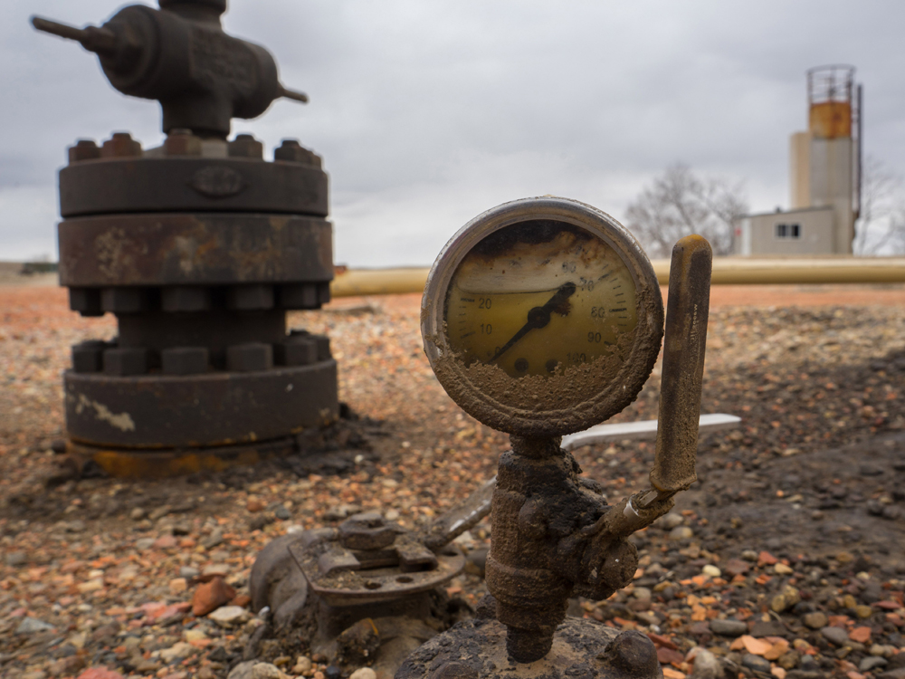 An oil gauge likely from the 1970s at an old well site.