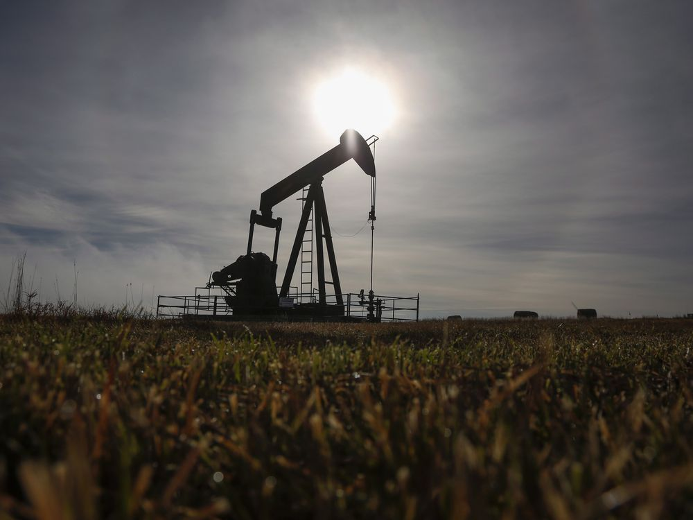 A pumpjack works at a well head on an oil and gas installation near Cremona, Alberta.