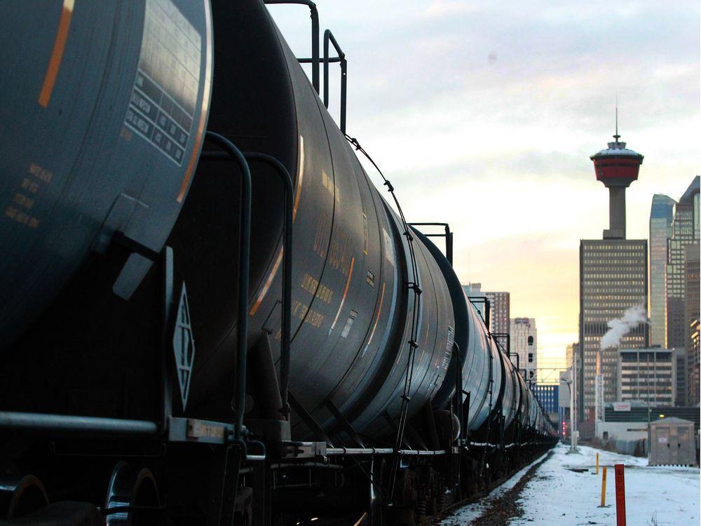A train carrying oil cars passes through Calgary on Nov. 29, 2018.