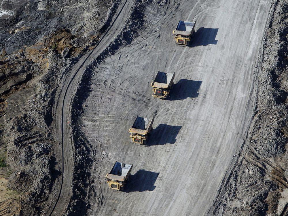Dump trucks carrying oilsands at a Suncor Energy mine.