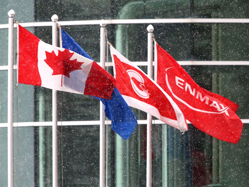 Canada, Alberta, City of Calgary and Enmax flags fly in downtown Calgary on Friday, October 23, 2020.
