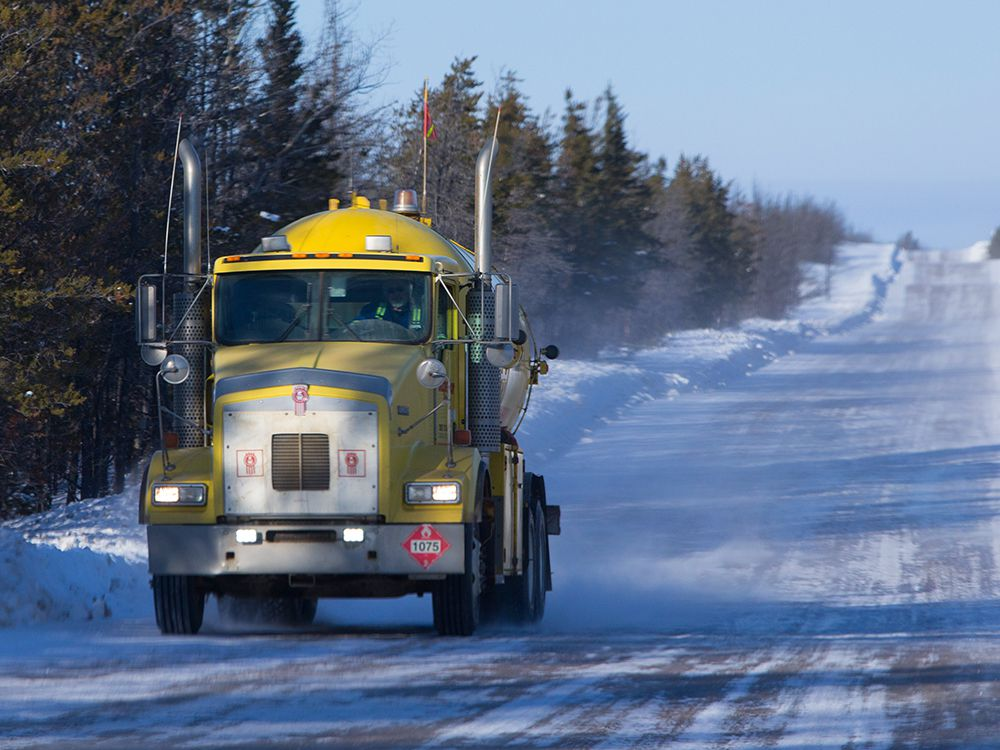 A fuel truck drives down the winter ice road from Fort McMurray to Fort Chipewyan in Northern Alberta on February 4, 2015. The 200-km temporary road typically opens mid-December and closes mid-March depending on the weather.