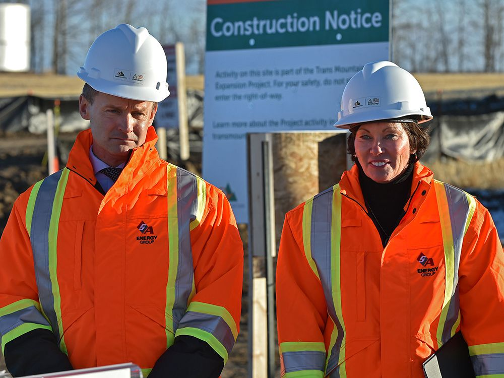 FILE PHOTO: Seamus O'Regan, Federal Minister of Natural Resources, Sonya Savage, Alberta Minister of Energy, at the Trans Mountain Expansion Project just west of Edmonton in 2019.