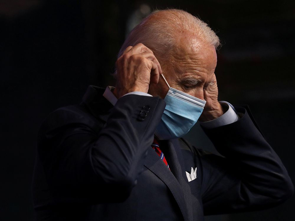 U.S. President-elect Joe Biden puts a mask on as he leaves the lectern after making remarks about the economy and the final U.S. jobs report of 2020 at his transition headquarters in Wilmington, Delaware, U.S., December 4, 2020.