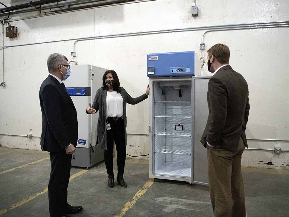 Kari Bergstrom, manager, Immunization, Business with Alberta Health, provides logistical highlights of the Provincial Vaccine Depot to Alberta's Minister of Health Tyler Shandro, right, and Deputy Minister of Health Paul Wynnyk, left, on Monday, Dec. 14, 2020.