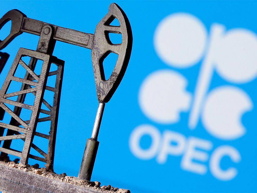 FILE PHOTO: A 3D printed oil pump jack is seen in front of displayed OPEC logo in this illustration picture, April 14, 2020.
