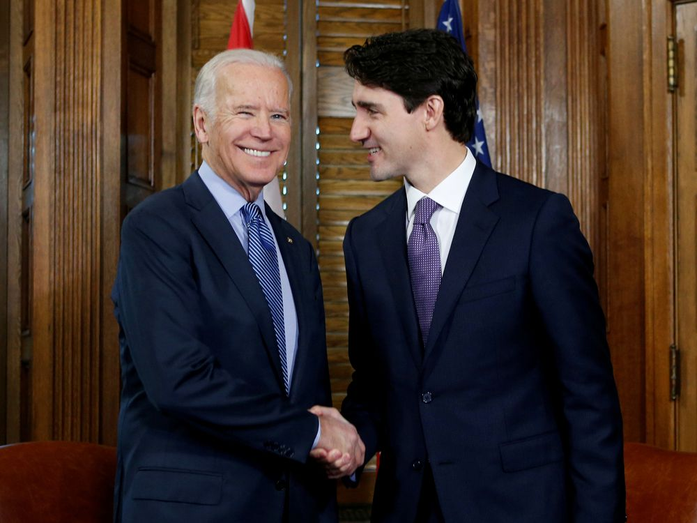 Prime Minister Justin Trudeau shakes hands with then-U.S. Vice President Joe Biden during a meeting in Trudeau's office in Ottawa in 2016.