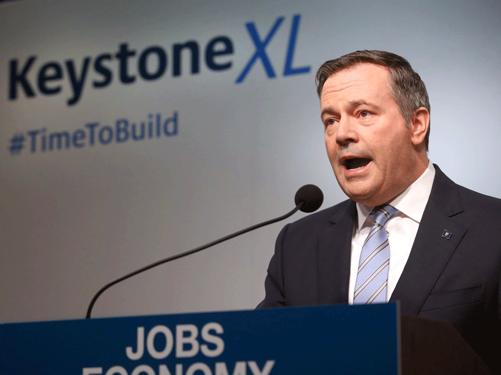 Alberta Premier Jason Kenney speaks in Calgary on March 31, 2020 about the the plan to kick-start construction on the Keystone XL pipeline.