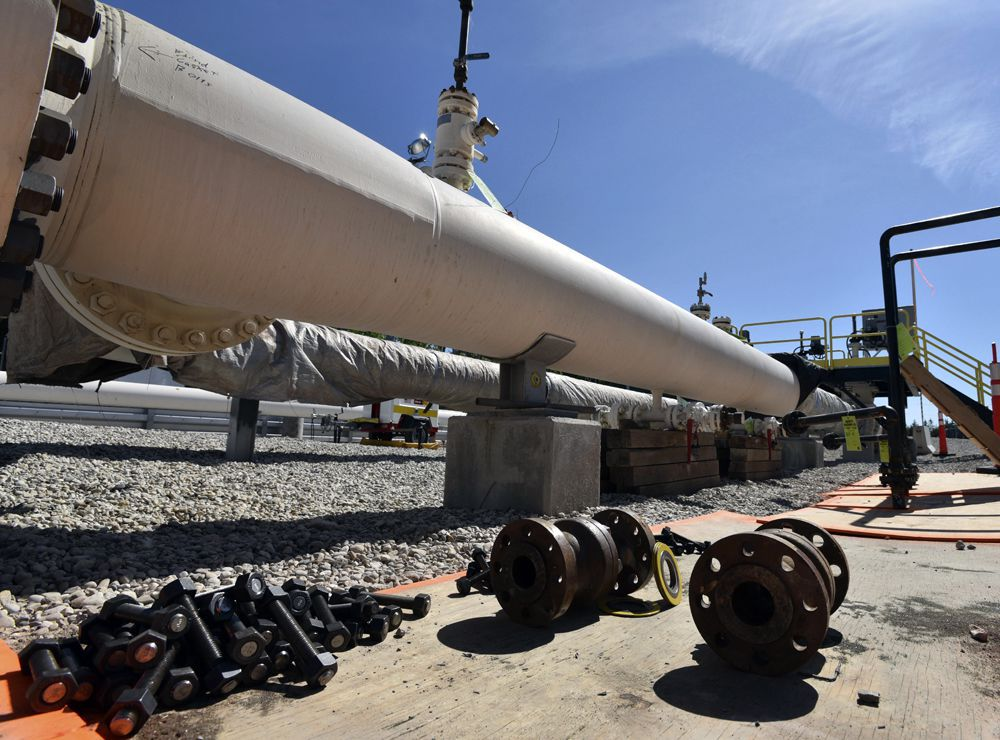 In this June 8, 2017, file photo, fresh nuts, bolts and fittings are ready to be added to the east leg of the pipeline near St. Ignace, Mich., as Enbridge prepares to test the east and west sides of the Line 5 pipeline under the Straits of Mackinac in Mackinaw City, Mich.