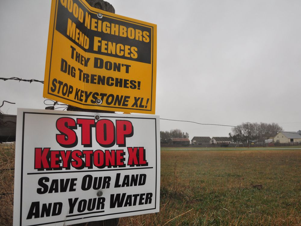This file photo taken on April 17, 2013, shows signs attached to a fence on the property of Jim Tarnick, a farmer opposed to the Keystone XL pipeline in Fullerton, Nebraska.