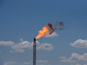 A flare burning off excess gas at an oil production site.