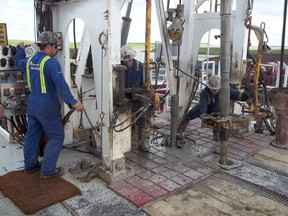 Roughnecks operate a drilling rig for Crescent Point Energy in Saskatchewan in 2012.